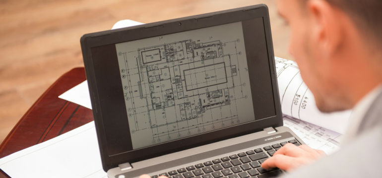 Engineer Or Architect Working With Blueprints